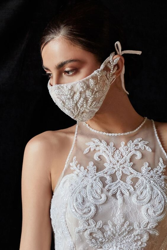 """Featured Samila & Company' s """" M03"""" beaded floral rococo mask. Samilia & Co have a trio of mask options featuring lace, beading, and cotton in aqua, black, ivory, and sand colors."""