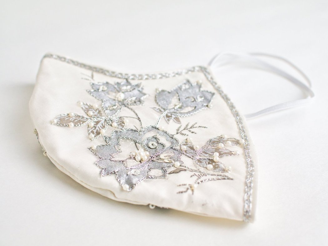 Known for her custom wedding accessories, Victoria's Bridal (known on Etsy as BellaVittoria ) has taken her creative talents and created a stunning line of facial masks. Featured above is her Formal Bridal White Face Mask with Silver Beaded Appliqué . Other designs feature eyelash trims or floral printed fabrics with blue or pink backgrounds, among other safe and beautiful designs.