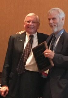 Dr. Ken Wells (Right)