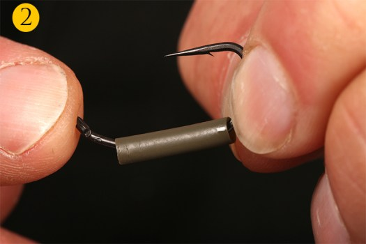 You then position the shrink tubing on the hook shank.