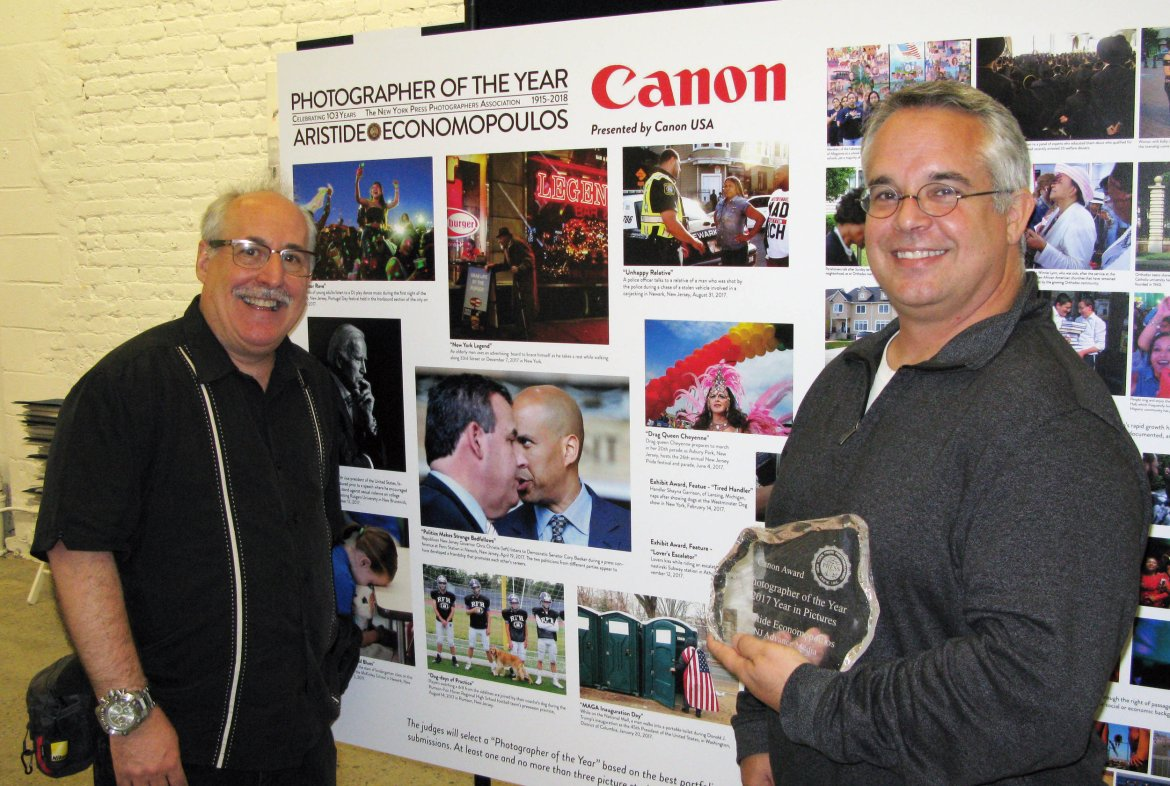 NYPPA President Bruce Cotler presents Aristide Economopoulos | NJ Advance Media with The Canon Photographer of the Year Award at the 198 Gallery in Brooklyn on May 17, 2018