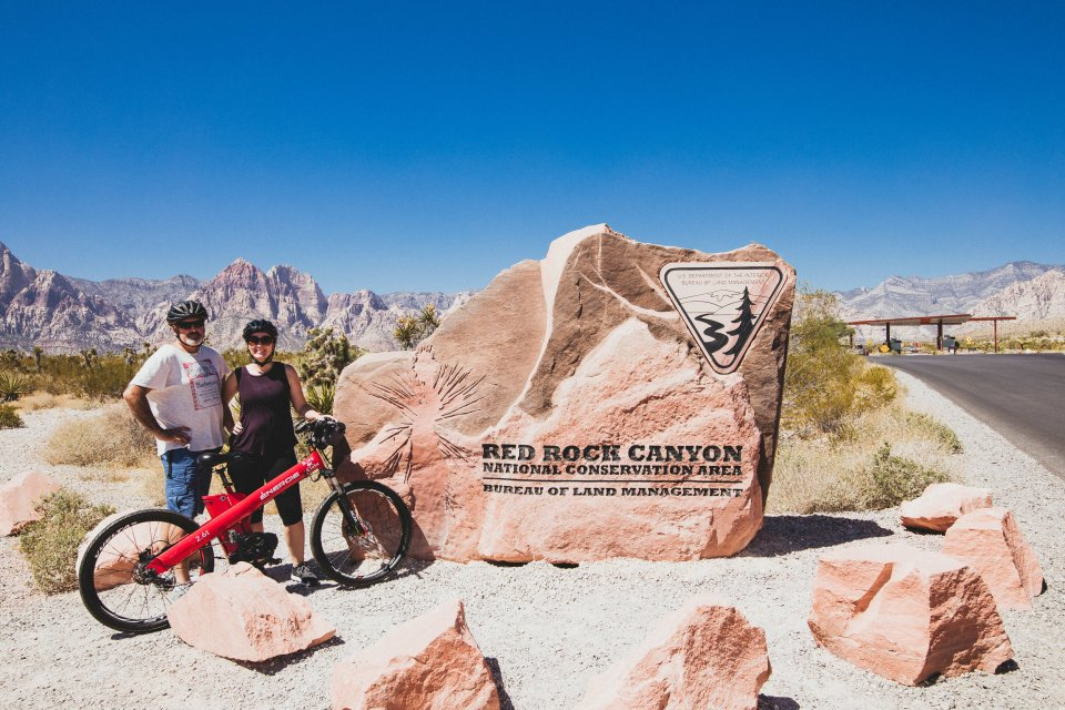 My husband and I and our e-bikes in Red Rock Canyon.