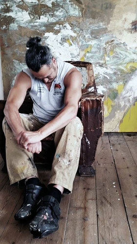 Kim Wan in front of his painting in the studioPhoto credit: ©Annie Morris