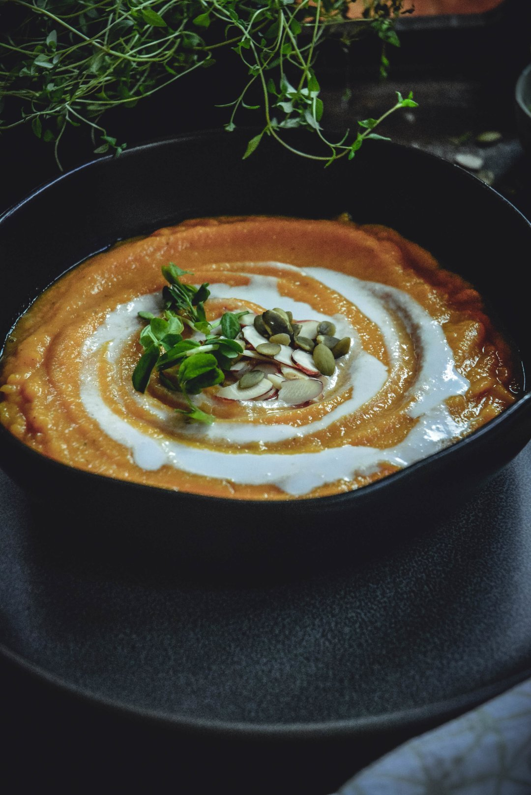 Here is a simple, warming butternut squash soup recipe that's you're going to love. Roasting the vegetables first, gives them a delicious, hearty flavor. This butternut squash soup is paleo, vegan and whole 30 approved too and just plain delicious! #soup, #fall, #calmeats, #butternutsquashsoup, #vegan, #whole30, #grainfree, #glutenfree, #dairyfree, #fallsoup, #whole30soup, #vegansoup, #paleosoup, #curriedsoup, #curriedbutternutsquash