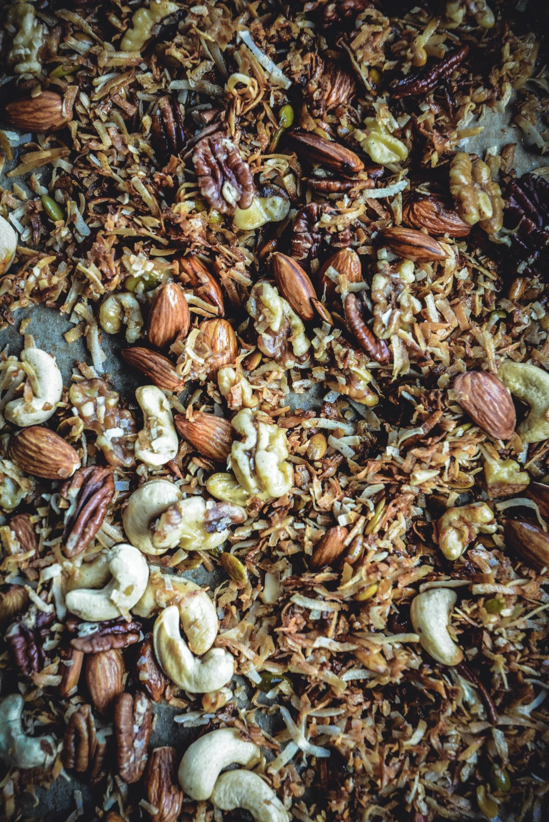 If you follow a mostly paleo diet and miss granola, try this gluten free, paleo and vegan version that's sure to satisfy your crunchy craving. #paleo #granola #calmeats #vegan #glutenfreegranola #vegetarian #paleofood #realfood #breakfast #snack #paleobreakfast #breakfast #grainfree