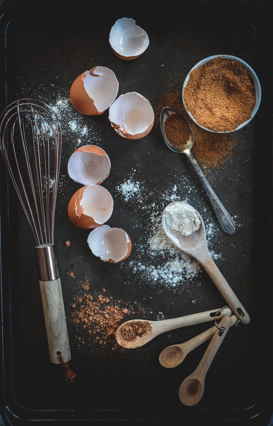 egg shells, whisk and cacao on spoons