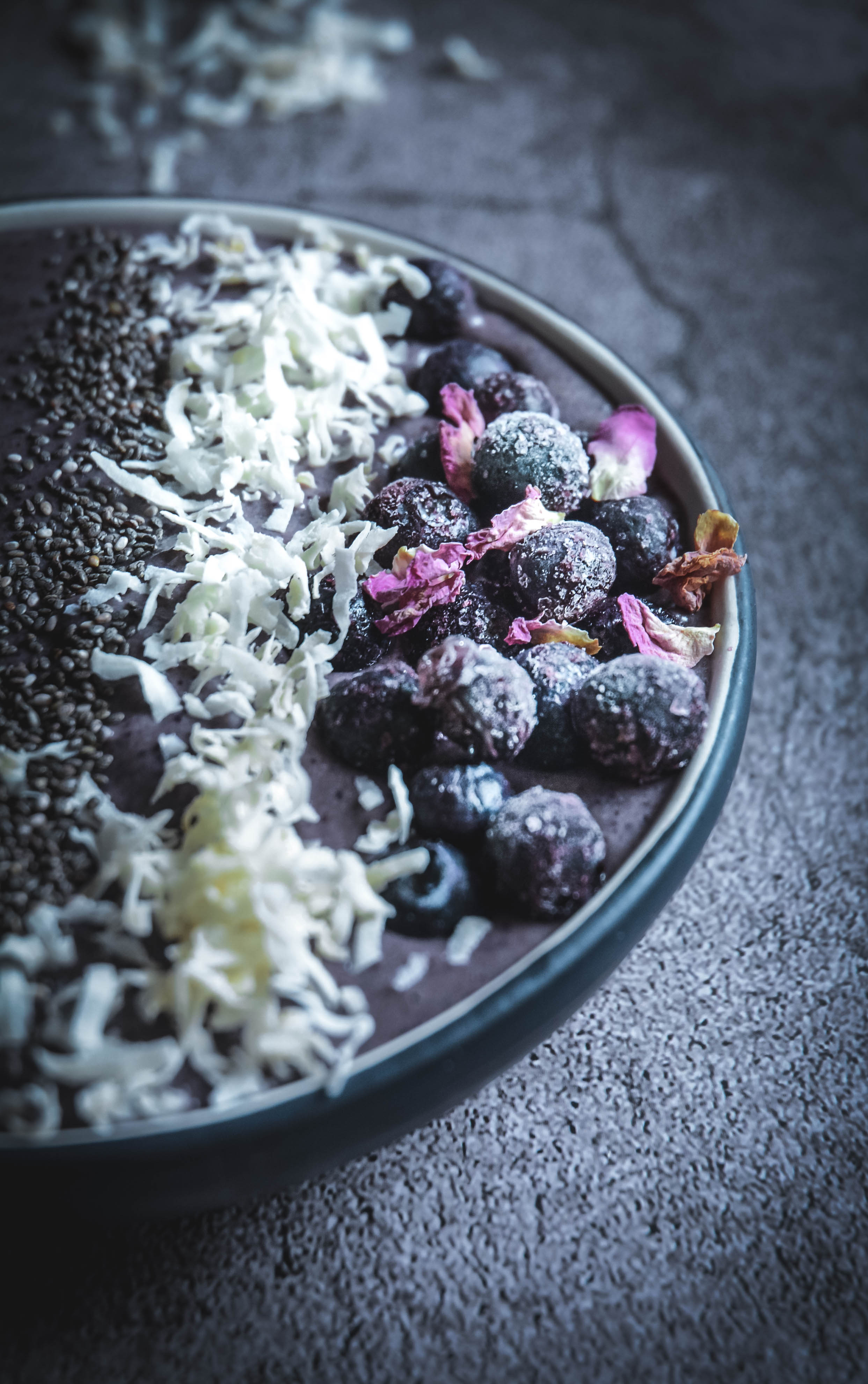 Smoothie bowl with frozen blueberries, coconut flakes