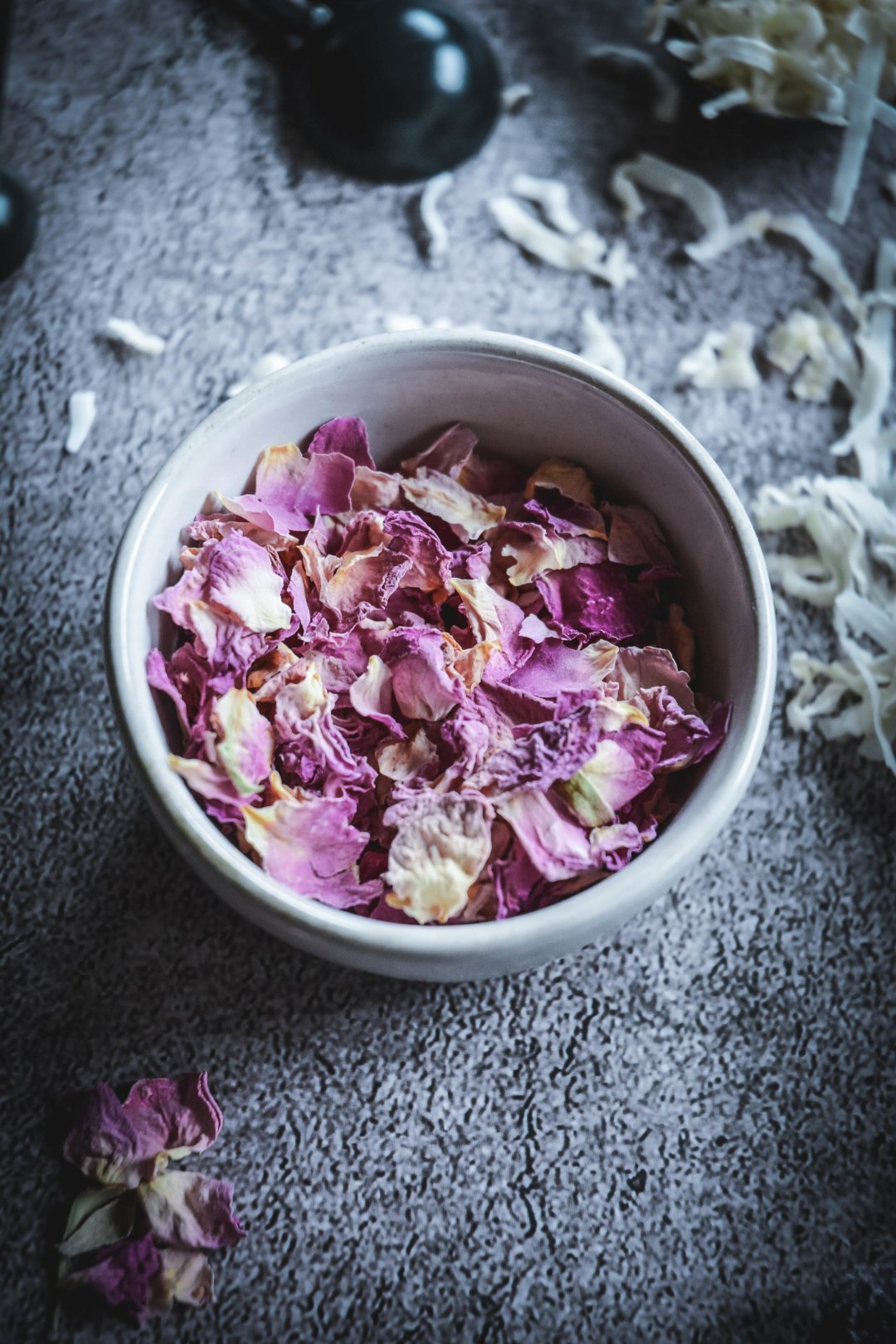 Dried rose petals in bowl