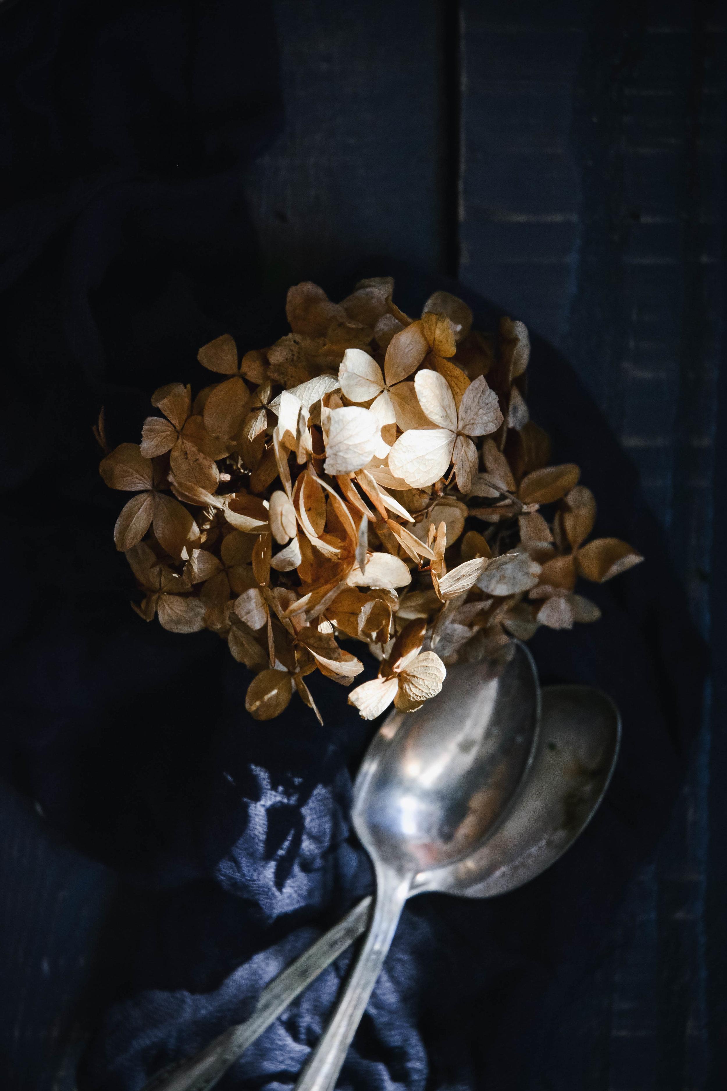 Dry hydrangea with spoons