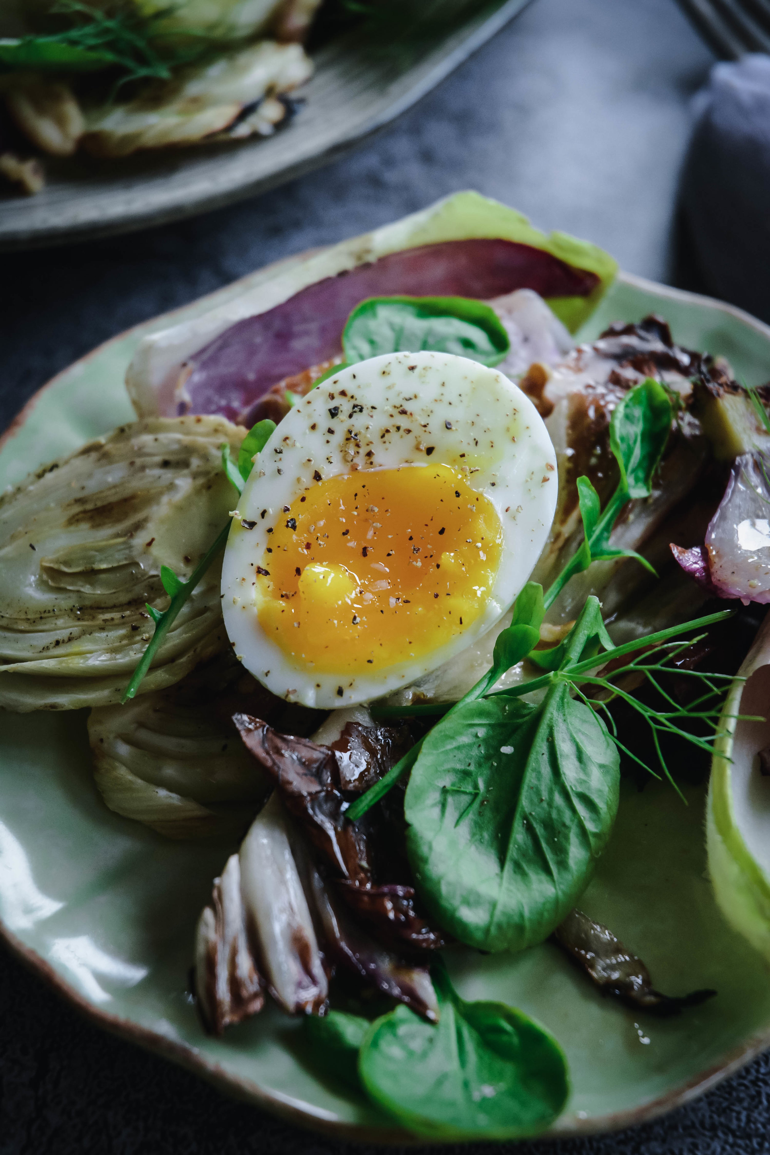 Soft boiled egg on greens