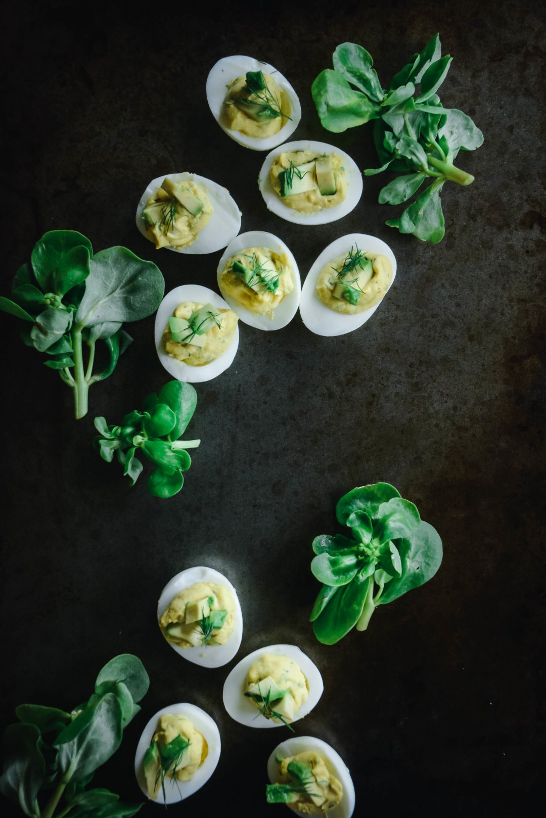 deviled eggs on table with greens
