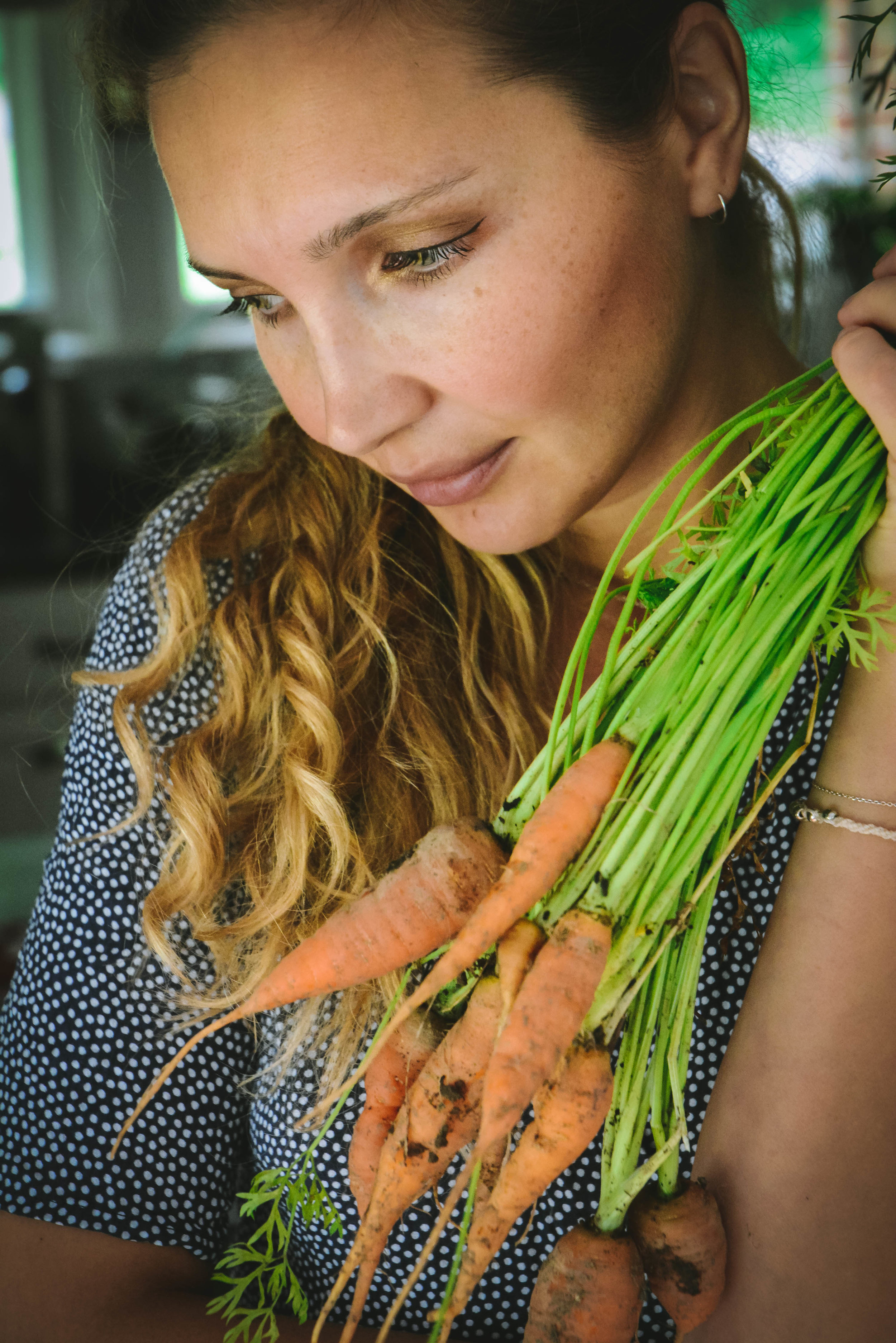 Woman holding carrots