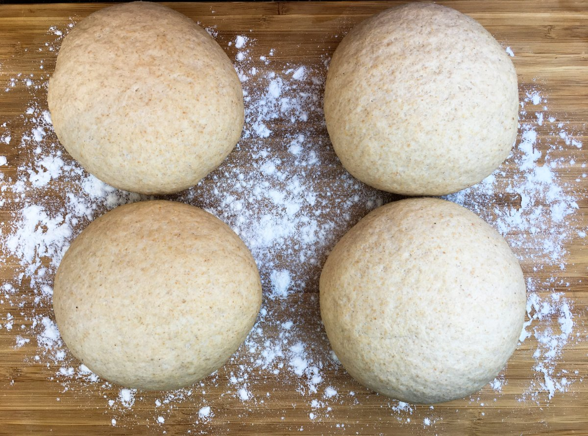 Rested dough balls ready to be stretched into pizza crust or calzones.