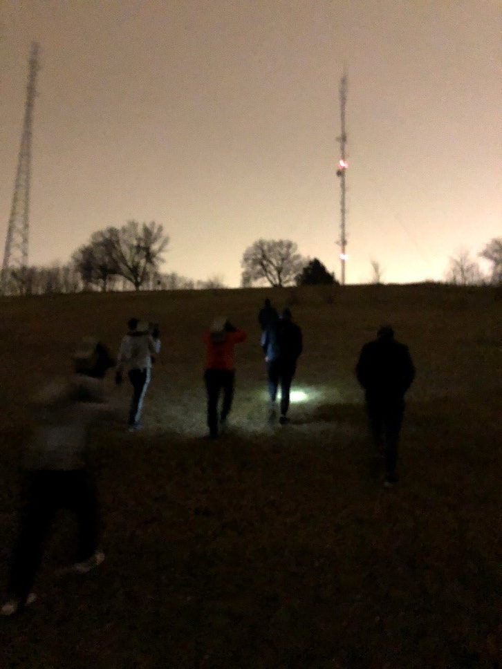 The PAX carry their coupons up the hill at Belknap Park during Kraut's workout entitled 'Ruck Yeah'
