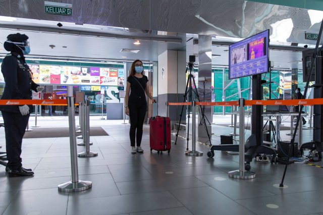 Photo caption: A guest going through body temperature screening check at Kuala Lumpur International Airport (klia2) in Kuala Lumpur.