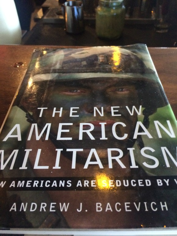 The New American Militarism by Andrew J Bacevich. (That worn cover has seen a lot of moves and a lot of years. Passing this one on. Don't mind the spilled Roy Street coffee on the counter. It might be tomato soup.)