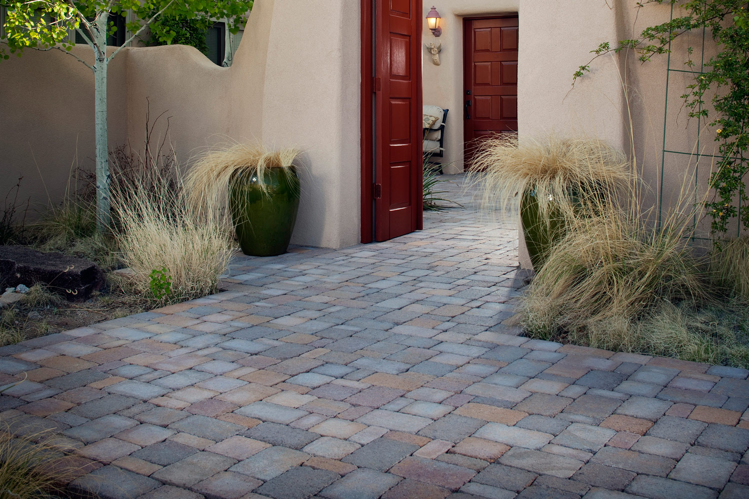 walkway and patio installation using concrete pavers on a slope bayside pavers