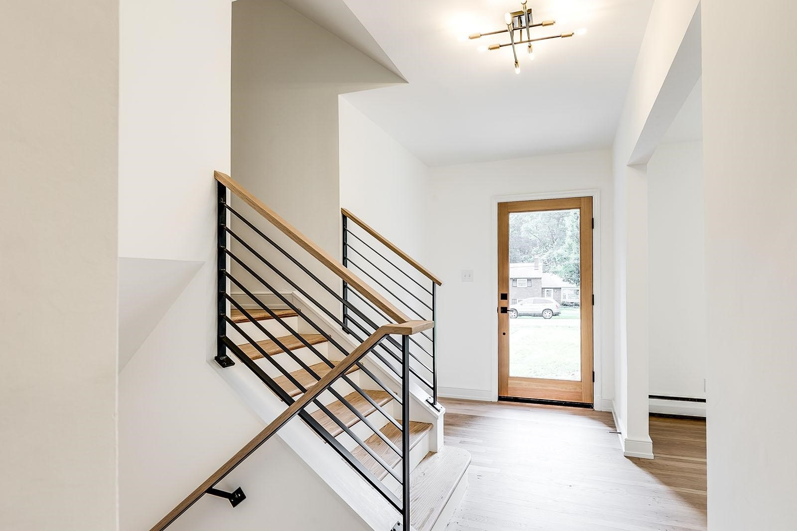 Project Case Study Modernizing A Mid Century Split Level — Ric | Mid Century Modern Stair Handrail | Vertical | Decorative | Fixer Up | Living Room | Contemporary Curved Staircase