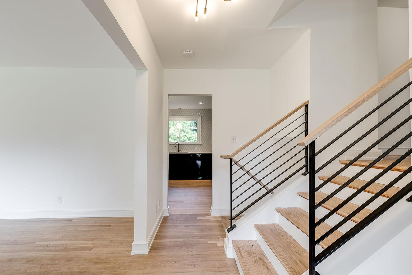 Project Case Study Modernizing A Mid Century Split Level — Ric | Split Level Entry Stairs | Raised Ranch | Tri Level | Modern | Knee Wall | Entrance