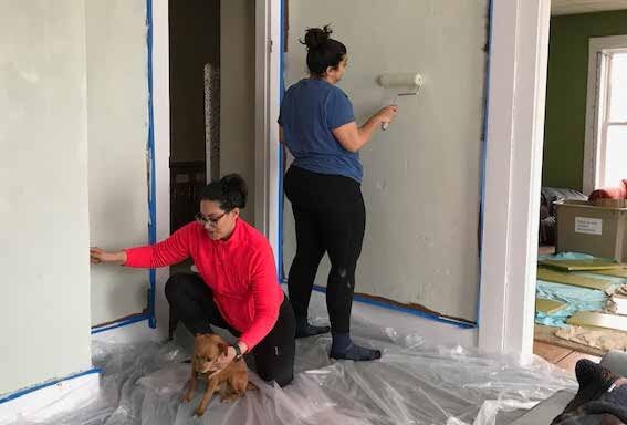 Alia Quart Khan, left, and Sultana Khan (along with four-legged assistant Rupert) put a fresh coat of paint on the walls of the Bethany Church office in a space that is being renovated to serve as emergency short-term housing. Courtesy photo.