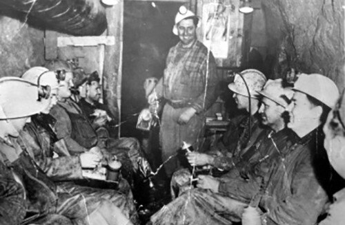 Miners enjoying lunch underground during the 1942-1958 revival. At this point hard hats had replaced leather caps, and headlamps had replaced candles. (Provided / University of Vermont Archives)