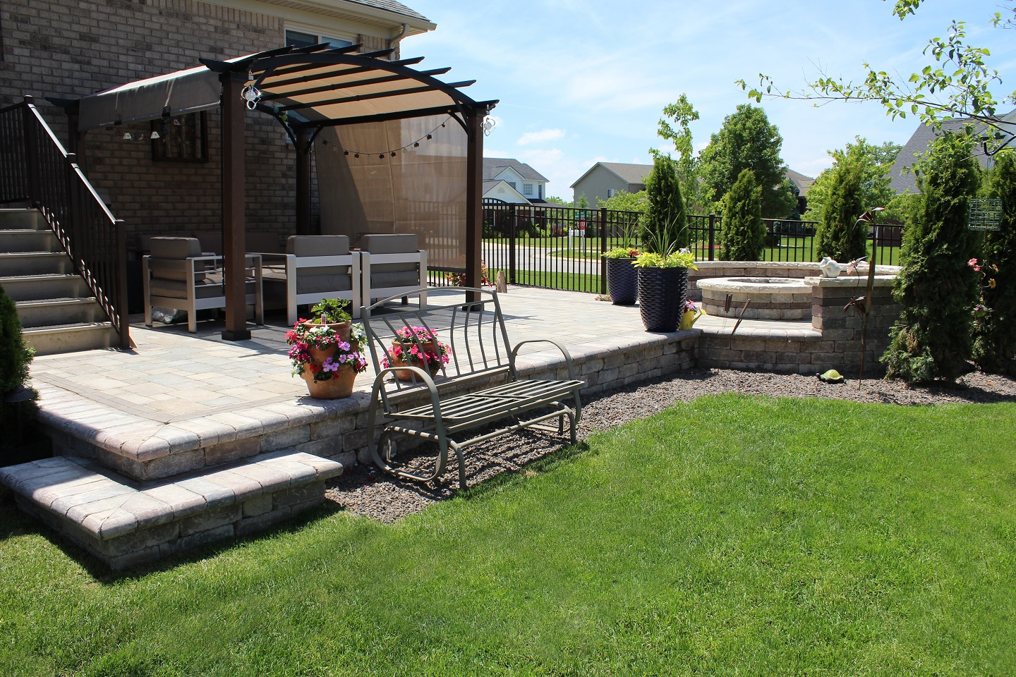 landscaping paver patio and lawn care