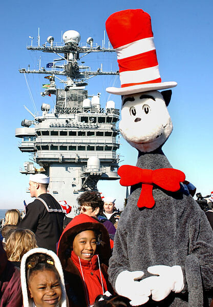 """At sea aboard USS George Washington (CVN 73) March 1, 2002 -- Hampton Roads elementary students take a tour on the flight deck during events held aboard shop to commemorate the national """"Read to Kids, Read Across America"""" campaign, held on the birthday of the famous kids book author Dr. Seuss. George Washington is conducting carrier qualifications off the Virginia coast. U.S. Navy photo by Photographer's Mate 3rd Class Bobbie Attaway. Public domain, via Wikimedia Commons"""