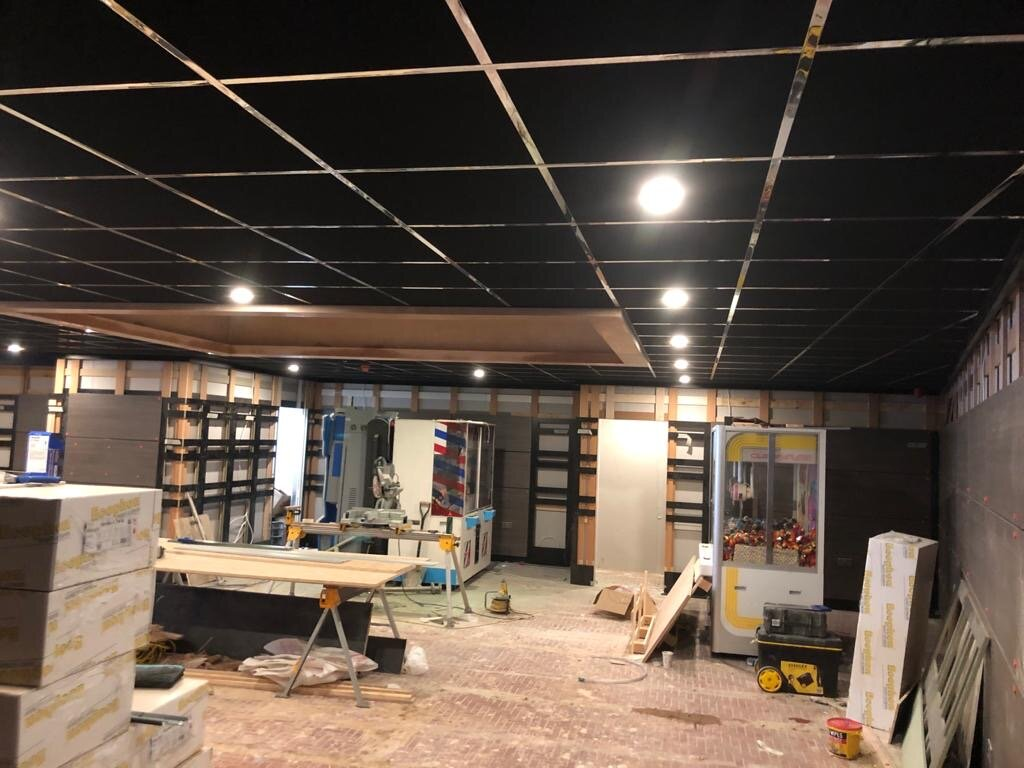 black suspended grid and tile ceiling