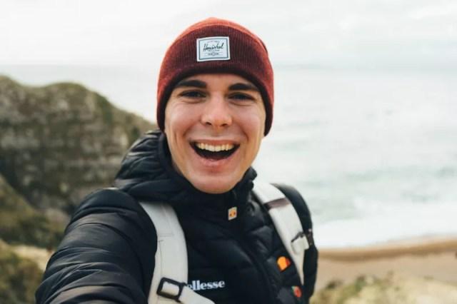 man taking selfie on seashore