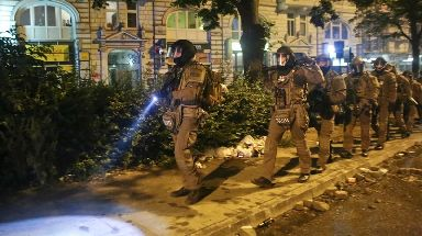 Heavily armed special police forces walk through the so-called 'Schanzenviertel' area.