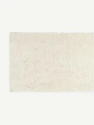 tapis en blanc maintenant des 24 00