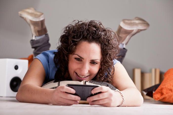 mobile gaming phone woman