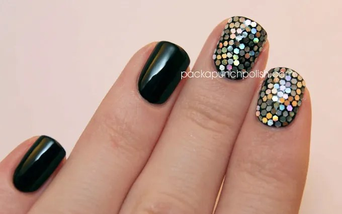 The Black And Silver Glitter Placement Nail Art Contain A Background With Colorful Tiny Hexagonal Objects Coated Over It Design Looks