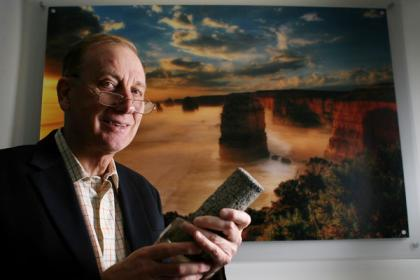 Dr Peter Cook holds sandstone from the Otway Basin, where 10,000 tonnes of carbon dioxide has been stored underground.