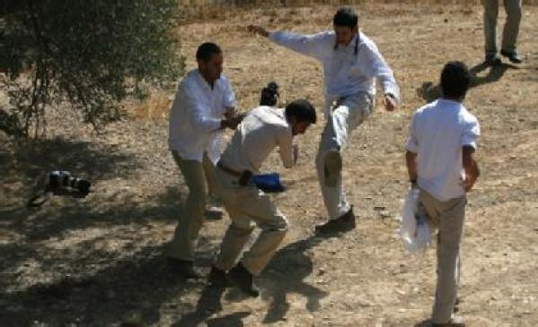 Israeli settlers attack Palestinian news photographer Abed Hashlamoun during the olive harvest near Hebron.