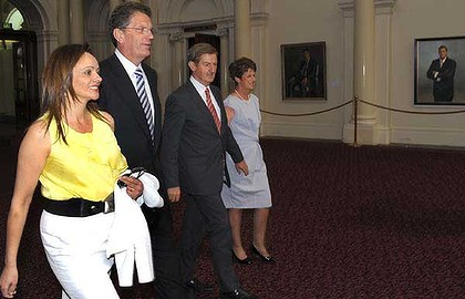 Ted Baillieu and wife Robyn with deputy Peter Ryan and wife Trish walk past portraits of past premiers in Queens Hall, Parliament House.