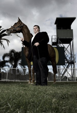 Mining magnate Nathan Tinkler poses at Randwick Racecourse with one of his mares.