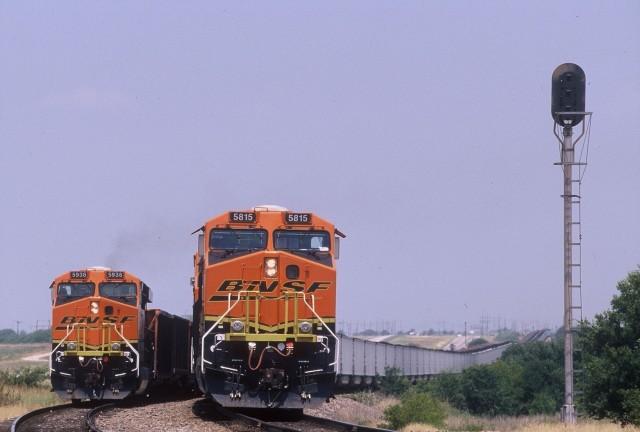 Two BNSF locomotives hauling coal trains meet near Wichita Falls, Texas