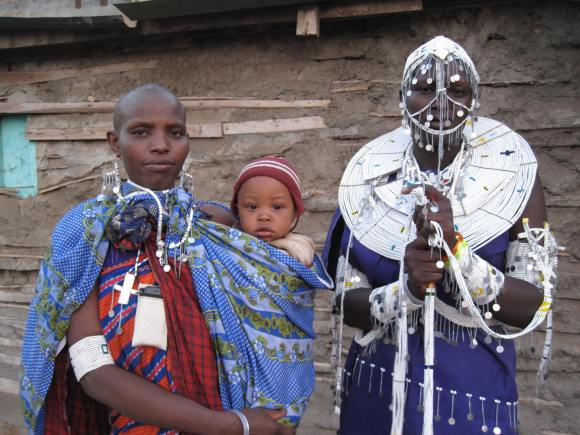 Image of two Maasai women dressed in traditional attire including Maasai beads and shukas (blankets)