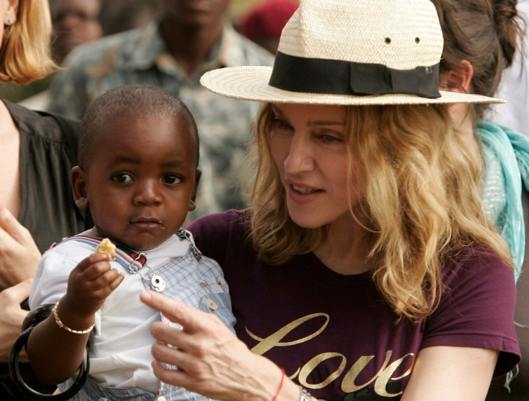 Madonna with her adopted son, David Banda, at an orphanage, 40 km from the capital Lilongwe April 19, 2007. Siphiwe Sibeko/Reuters