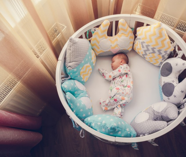 There Shouldnt Be Anything In The Cot With The Baby From Www Shutterstock Com Some Parents Are Concerned Sleeping