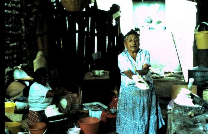 Woman prepares cornmeal for tortillas
