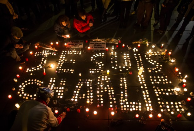 Candelit vigil for victims of the Charlie Hebdo attack, spelling 'Je suis Charlie'.