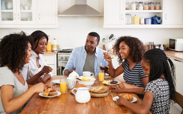 Family eating breakfast together.