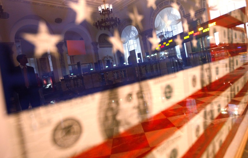 Picture of US flag with stock listings reflected in it
