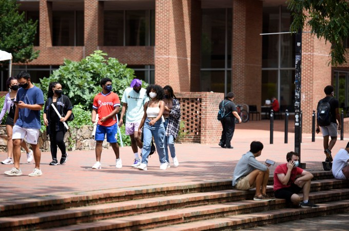 Students in masks walk on the University of North Carolina Chapel Hill campus.