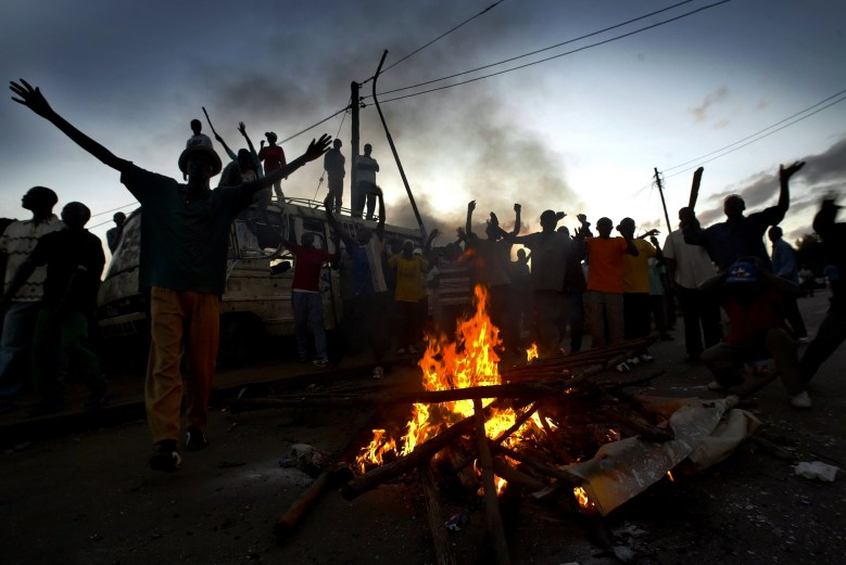 Protesters around a bonfire