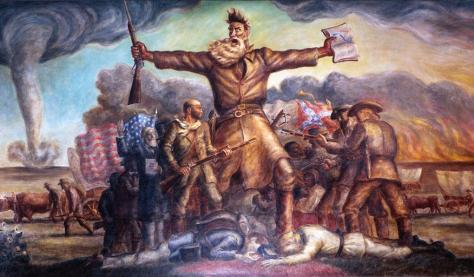 John Brown, arms splayed out, triumphantly screams as troops battle behind him.