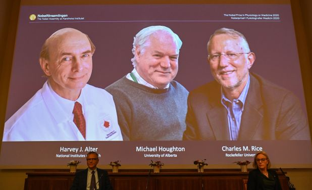 three scientist projected on screen at announcement
