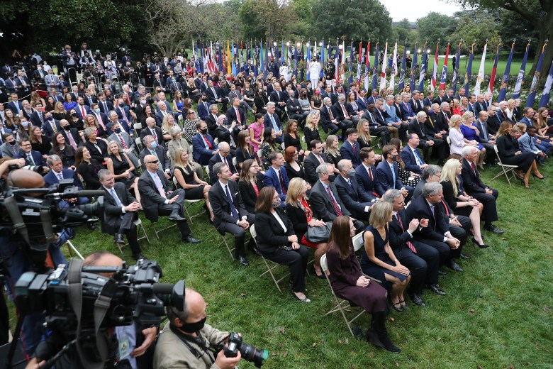 The crowd seated side-by-side in the Rose Garden.